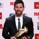 Barcelona's Lionel Messi poses with his Golden Boot trophy during a ceremony in Barcelona